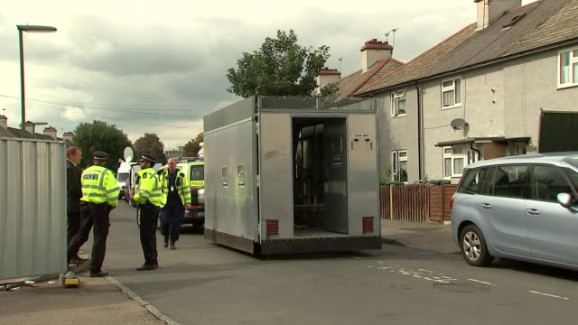 Police lift cordon in SunburyonThames ENGLAND Surrey SunburyonThames EXT Various of barriers forming the police cordon across Cavendish Road being...