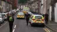 Police make two further arrests DAY Various shots police officers guarding Newport house where asylum seekers lived Various shots police cordon
