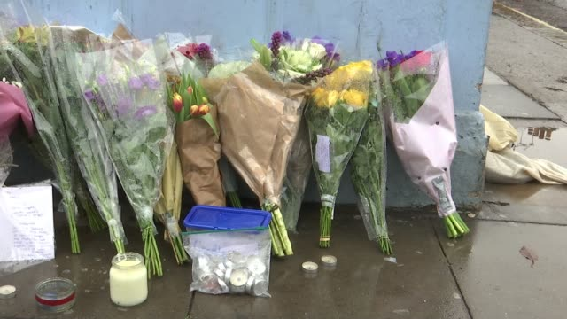 teenager charged with murder of Omid Saidy Parsons Green EXT Various of 'RIP Omid' sign and flowers floral tributes outside outside Parsons Green...