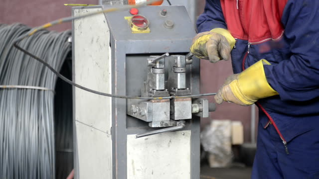 part of the machine for welding wire mesh in action