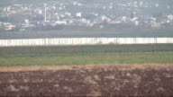 Part of wall under construction is seen along the border with Syria in the town of Reyhanli in Hatay province Turkey on October 15 2015 to take...