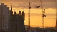 Partial Cardiff Castle tower off center some city buildings construction cranes BG UK
