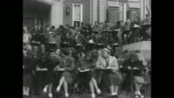WS partial side view of students on steps in front of building on campus of LenoirRhyne College / WS head on view of students seated with building in...