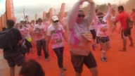 Participants at Chicago's annual Color Run started the 5K run with white tee shirts then got blasted with biodegradable dyes along the route on June...