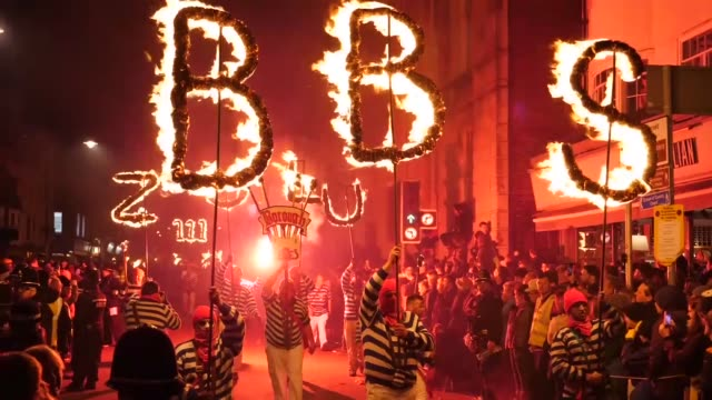 Participants carrying torches take part in the annual Bonfire Night celebrations in the East Sussex town of Lewes England on November 04 2017