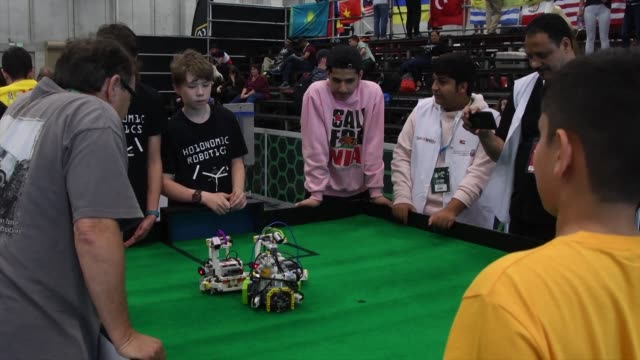 Participants from all over the world take part in the World Robot Olympiad with their miniature robots at a convention center in San Rafael Costa...