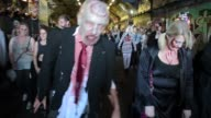 Participants in zombie costumes and wearing zombie makeups take part at the event which runs in more than 50 cities across the globe during the World...