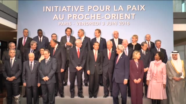 Participants pose for a family photo during an international meeting in a bid to revive the IsraeliPalestinian peace process in Paris France on June...