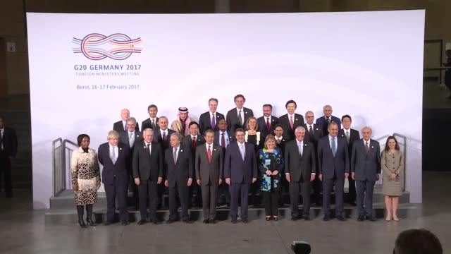 Participants pose for a family photo during the G20 Foreign Ministers' meeting at the World Conference Center in Bonn Germany on February 16 2017