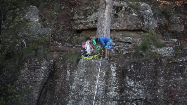 Participants set up a highline and safety ropes between cliffs at Corroboree Walls in Mount Victoria on March 6 2015 in the Blue Mountains Australia...