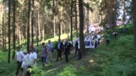 Participants walk from Nezuk to Potocari during 'peace march' at Nezuk village of Bosnia and Herzegovina on July 8 2016 to mark the 21st anniversary...