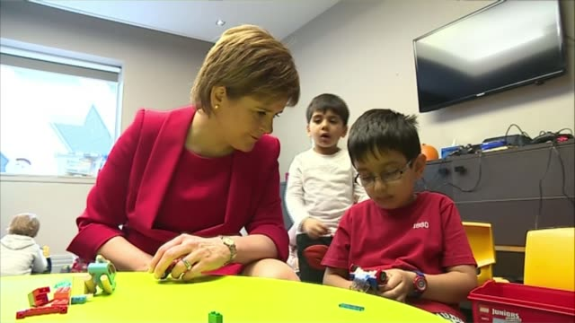 Nicola Sturgeon pledges to fight 'extreme Brexit' Glasgow INT Nicola Sturgeon MSP seated talking to young boy who looks at her nonplussed SOT I am...