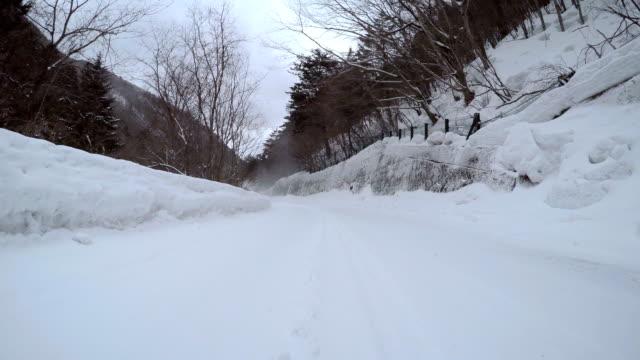 pass a snowplow at snow mountain road