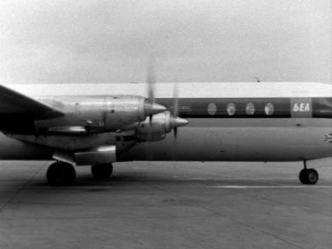 A BEA passenger aircraft taxiis across a runway