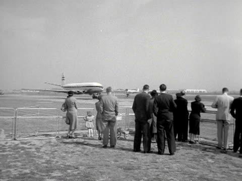 A BOAC passenger aircraft taxis across the runway at London Airport 1953