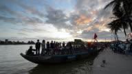 MS Passenger boat being unloaded at Bach Dang Docks during sunset / Hoi An, Quang Nam, Viet Nam