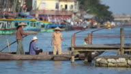 MS Passenger disembark from wooden boat on thu bon river / Hoi An, Quang Nam, Viet Nam