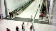 passenger taking escalator in airport,time lapse.