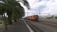 WS PAN Passenger train passing through station / Western Cape, South Africa