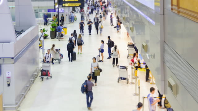 Passengers and world travelers check in at airport.