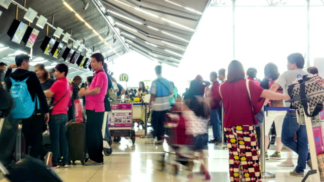 Passengers at Airport Check In Counter,Panning Shot