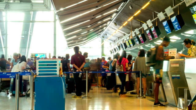 Passengers at Airport Check In Counter,Zoom in