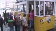 Passengers board a tram in Lisbon, Portugal.