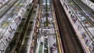 TL, HA, WS Passengers board and disembark from trains at rush hour in Osaka station / Osaka, Japan
