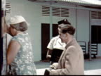 1957 MONTAGE Passengers board Malayan Airways bus while flight attendant watches. Bus pulls away. Passengers riding on bus. / Singapore / AUDIO
