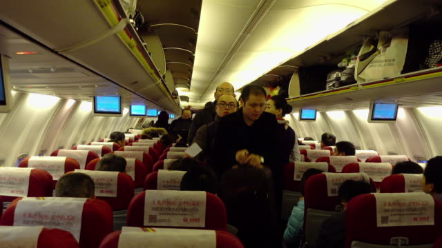 Passengers boarding and finding their seats