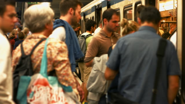 Passengers Boarding Subway Train
