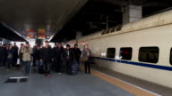 Passengers getting off from a CRH train walking on platform Nearly 3 billion trips are estimated to be made by Chinese during the upcoming Spring...