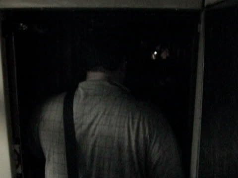 Passengers leaving subway train and entering subway tunnel during citywide blackout on August 14 2003 / New York New York USA / AUDIO