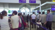 Passengers line up to get through security in airport