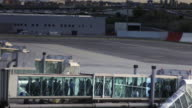 Passengers on Jetway at Madrid Barajas International Airport (Time Lapse)