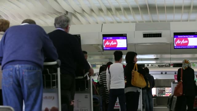 Passengers queue behind Hong Kong Express cordon tape at Hong Kong International Airport in Hong Kong China on Monday March 10 General views...