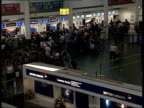 Passengers queuing at airport check in desks