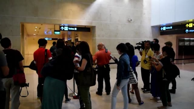 Passengers relatives gather at Singapore airport as a search is underway for an AirAsia plane carrying 162 people which has gone missing in bad...
