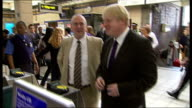 Passengers security and public notices on the tube / Boris Johnson photocall and interview after alcohol ban Passengers up stairs from platforms...