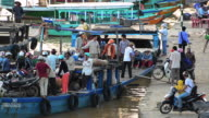 MS Passengers sitting with bicycles, bikes in Passenger boat at Bach Dang Docks, Hoi An / Hoi An, Quang Nam, Viet Nam