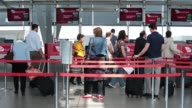 A passengers uses a Virgin Australia Holdings Ltd selfservice checkin machine at the domestic terminal of Sydney Airport in Sydney Australia on...