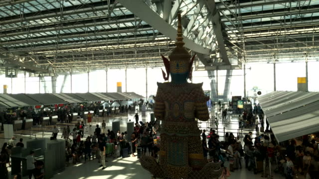 Passengers wait at the check in queue in departure terminal of Bangkok