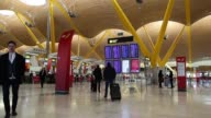 Passengers wait for luggage at baggage claim inside a terminal building at Madrid Barajas airport operated by Aena SA in Madrid Spain on Wednesday...