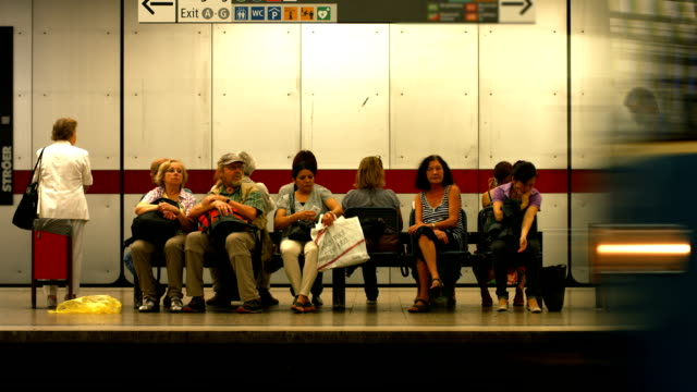 T/L Passengers Waiting For The Subway Train (4K/UHD to HD)