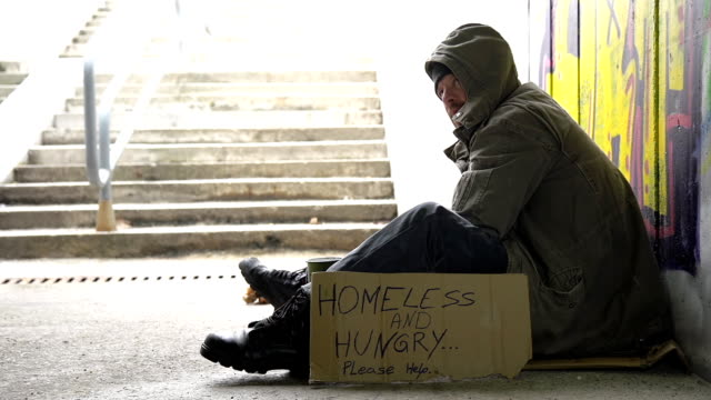 HD: Passer-by Gives Change To A Homeless Person