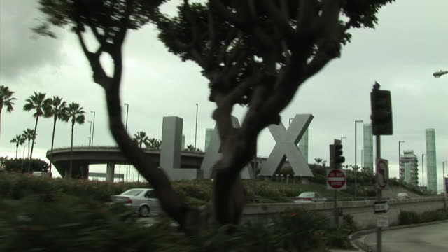 POV, Passing by LAX sign, Los Angeles, California, USA