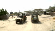 passing by Somali militia men Riding through village on July 31 2011 in Dhoobley Somalia