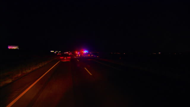 POV, Passing car accident scene on Interstate 10 at night, El Paso, Texas, USA