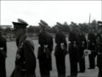Passing out parade at RAF Cranwell ENGLAND Lincolnshire RAF Cranwell EXT Jets overhead in formation / Wide shot parade ground / People seated / RAF...