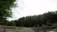 Passing through a wooden bridge